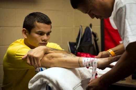 Robert Garcia wrapping Marcos Maidana hands